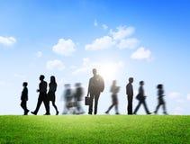 Бизнесмены в движении на совершенно новый день Стоковые Фотографии RF