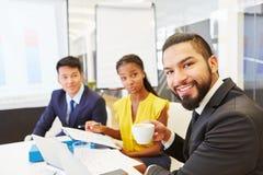 Бизнесмены в встрече команды Стоковое Фото