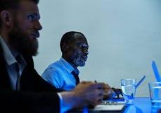 Бизнесмены в встрече Стоковая Фотография RF
