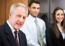 Бизнесмены в их офисе Стоковые Изображения