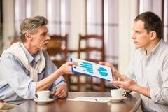 Бизнесмены в кафе Стоковые Фотографии RF