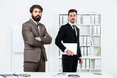 Бизнесмены в офисе Стоковое Фото