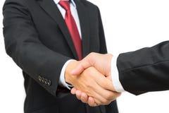Бизнесмены в черном костюме тряся руки Стоковое Изображение