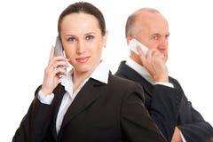 бизнесмены говорить телефона стоковая фотография