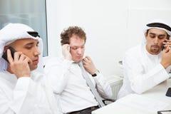 Бизнесмены говоря на встрече Стоковая Фотография RF