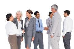 Бизнесмены говоря совместно Стоковое фото RF