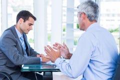 Бизнесмены говоря совместно Стоковая Фотография RF