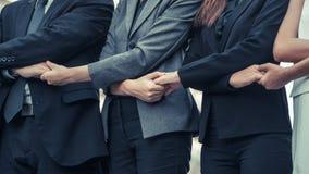 Бизнесмены держа руки показывая сыгранность Стоковое Изображение RF