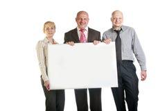 3 бизнесмены держа знамя Стоковая Фотография RF