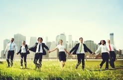 Бизнесмены держа концепцию рук совместно Outdoors Стоковая Фотография