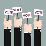 Бизнесмены держа шильдик с голосованием слова Много Хан Стоковые Фото