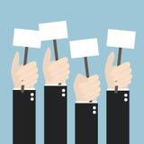 Бизнесмены держа шильдик с чистым листом бумаги Много h Стоковая Фотография RF