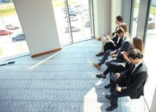 Бизнесмены ждать собеседование для приема на работу Стоковая Фотография RF