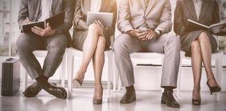 Бизнесмены ждать быть вызванным в интервью Стоковые Изображения RF