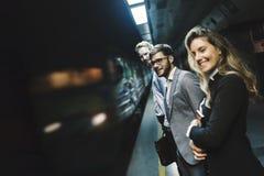 Бизнесмены ждать метро Стоковое Изображение