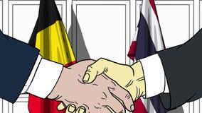Бизнесмены или политики трясут руки против флагов Бельгии и Таиланда Связанные официальное заседание или сотрудничество иллюстрация штока