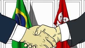 Бизнесмены или политики трясут руки против флагов Бразилии и Гонконга Связанные официальное заседание или сотрудничество бесплатная иллюстрация