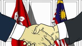 Бизнесмены или политики трясут руки против флагов Гонконга и Малайзии Связанные официальное заседание или сотрудничество бесплатная иллюстрация