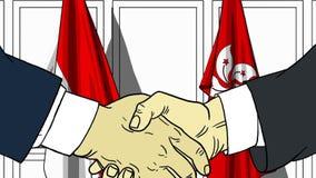 Бизнесмены или политики трясут руки против флагов Индонезии и Гонконга Связанные официальное заседание или сотрудничество иллюстрация штока