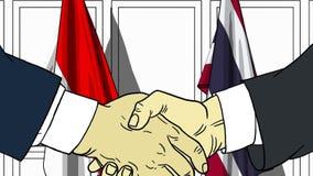 Бизнесмены или политики трясут руки против флагов Индонезии и Таиланда Связанные официальное заседание или сотрудничество иллюстрация штока