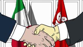 Бизнесмены или политики трясут руки против флагов Италии и Гонконга Связанные официальное заседание или сотрудничество иллюстрация штока