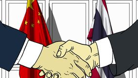Бизнесмены или политики трясут руки против флагов Китая и Таиланда Связанные официальное заседание или сотрудничество иллюстрация штока