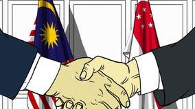 Бизнесмены или политики трясут руки против флагов Малайзии и Сингапура Связанные официальное заседание или сотрудничество иллюстрация штока
