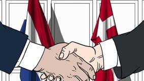 Бизнесмены или политики трясут руки против флагов Нидерландов и Дании Связанные официальное заседание или сотрудничество иллюстрация штока