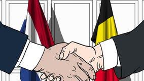 Бизнесмены или политики трясут руки против флагов Нидерландов и Бельгии Связанные официальное заседание или сотрудничество бесплатная иллюстрация