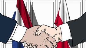 Бизнесмены или политики трясут руки против флагов Нидерландов и Польши Связанные официальное заседание или сотрудничество иллюстрация штока