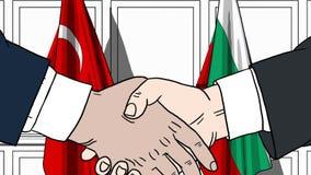 Бизнесмены или политики трясут руки против флагов Турции и Болгарии E иллюстрация штока