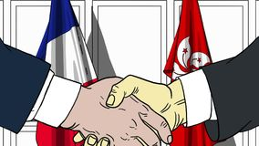 Бизнесмены или политики трясут руки против флагов Франции и Гонконга Связанные официальное заседание или сотрудничество бесплатная иллюстрация