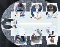 Бизнесмены имея встречу в офисе Стоковые Фотографии RF