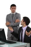 Бизнесмены имея обсуждение Стоковые Фотографии RF