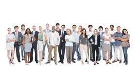 Бизнесмены и вскользь представлять людей Стоковые Фото