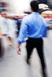 Бизнесмены на движении в городе Стоковое Изображение RF