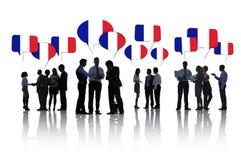 Бизнесмены обсуждая о Франции Стоковые Изображения