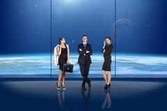 Бизнесмены перед окном Стоковые Изображения
