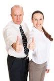 бизнесмены показывая большие пальцы руки smiley вверх стоковая фотография rf