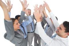 Бизнесмены поднимая их оружия Стоковое фото RF