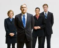 бизнесмены представляя совместно Стоковое Фото