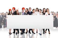 Бизнесмены представляя пустое знамя Стоковая Фотография