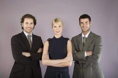 3 бизнесмены при пересеченные оружия Стоковые Фото