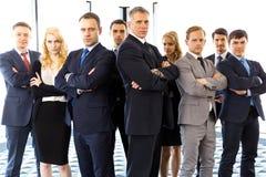 Бизнесмены при пересеченные оружия Стоковая Фотография