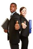 Бизнесмены при файлы держа большие пальцы руки вверх Стоковые Фотографии RF
