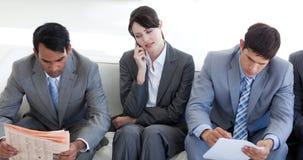 бизнесмены сидя ждать Стоковые Изображения RF
