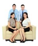 Бизнесмены сидя на кресле стоковая фотография