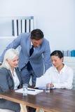 Бизнесмены смотря документы Стоковое Изображение RF