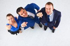 Бизнесмены стоя совместно - указывать вы Стоковые Фото