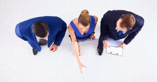 Бизнесмены стоя совместно - topview Стоковое Фото